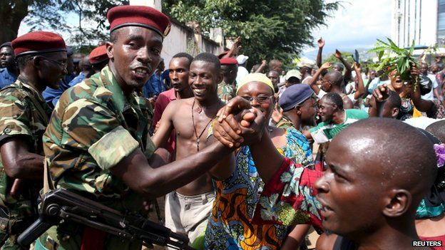 Protesters in Bujumbura celebrate the apparent dismissal of the president, 13 May
