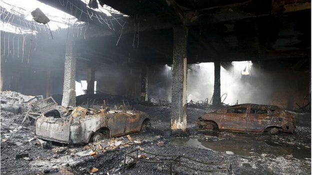 Burned cars inside the factory in Valenzuela, Metro Manila (14 May 2015)