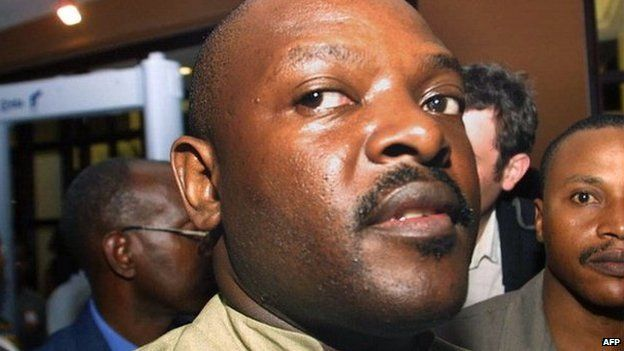 Leader of main Hutu rebel group Forces for Defence of Democracy (FDD) in Burundi Pierre Nkurunziza walks out 16 September 2003 of a closed- door meeting with Burundi President Domitien Ndayizeye in Dar Es Salaam