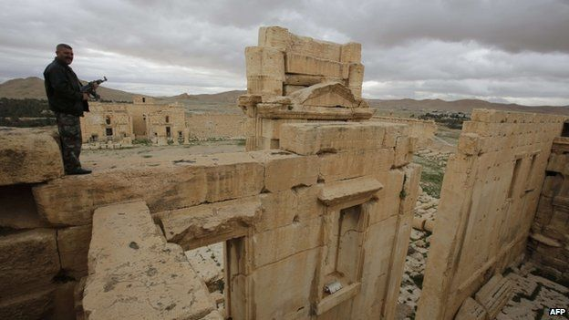 A Syrian policeman standing on the sanctuary of Baal in the ancient oasis city of Palmyra, 215 kilometres north-east of Damascus, on 14 March 2014