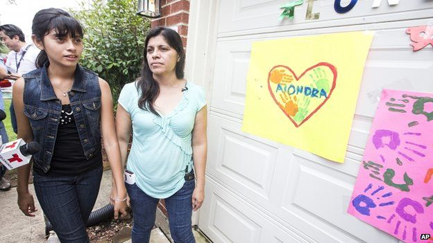 Alondra Diaz and her mother outside their house in Houston