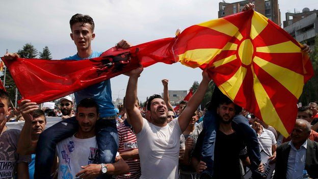 Anti-government protesters wave Albanian and Macedonian flags in Skopje protest (17 May)