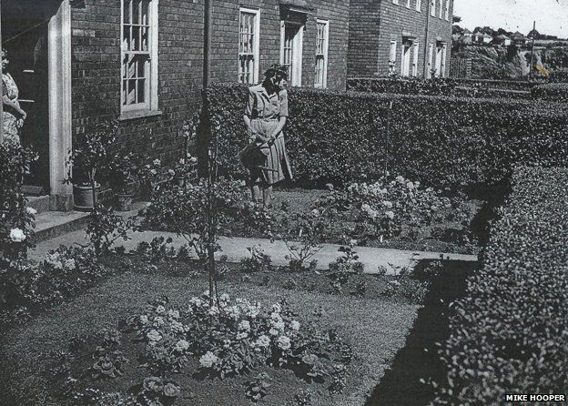 Woman tending to garden on the Becontree Estate
