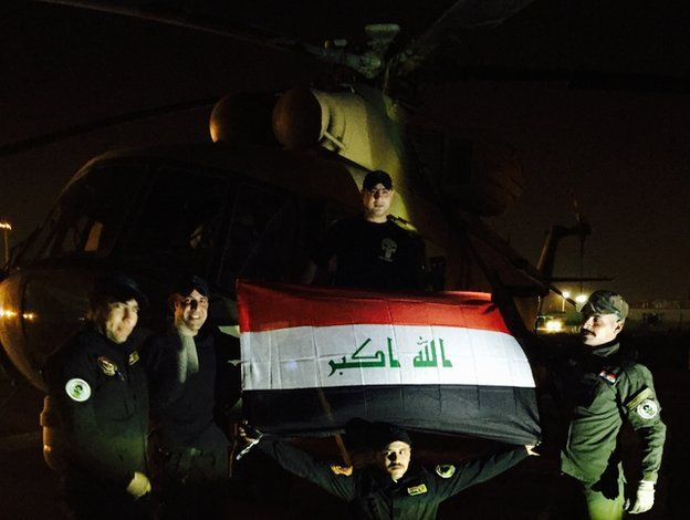 Iraqi pilots pose in front 19 May 2015