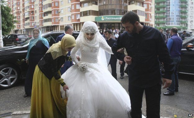 Kheda Goylabiyeva, is taken by head of the Chechen leader's administration Magomed Daudov to a wedding registry office for her wedding with Chechen police officer Nazhud Guchigov