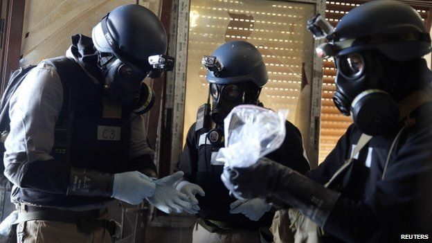 UN chemical weapons inspectors holding a plastic bag of samples in Damascus in August 2013