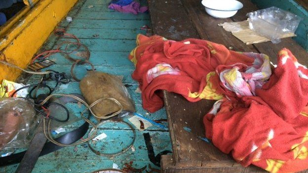 Dirty trawler that migrants lived on for more than two months