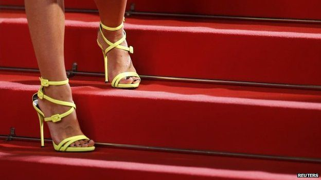 The shoes of an unidentified guest are pictured as she poses on the red carpet for the screening of The Lobster at the Cannes Film Festival