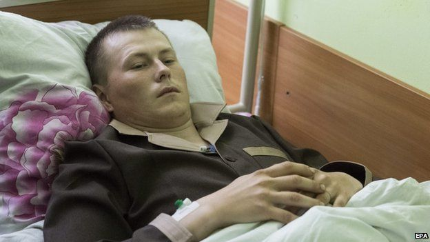 Alexander Alexandrov lies on a bed at a hospital in Kiev, Ukraine, 19 May 2015.