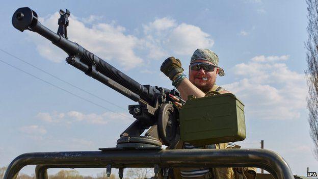 A Ukrainian servicemen at a check point near Schastye, Luhansk area, 12 April 2015.