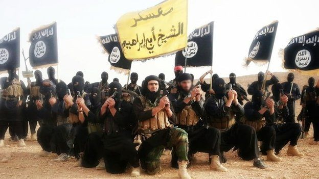 Islamic State fighters pose for a photo (1 June 2014)