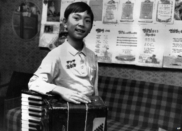In this June 1998 photo from North Korea's official Korean Central News Agency, distributed by Korea News Service, Kim Jong Chul as small child
