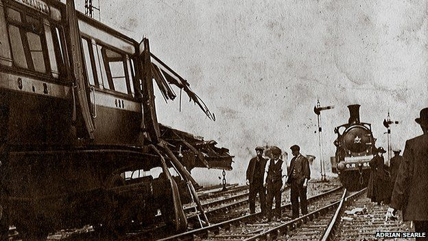 The wrecked leading coach of the local train