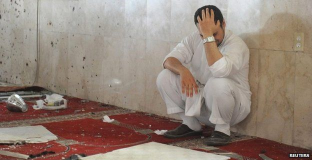 A family member of a slain victim mourns after arriving at the mosque attacked by IS in eastern Saudi Arabia - 22 May 2015