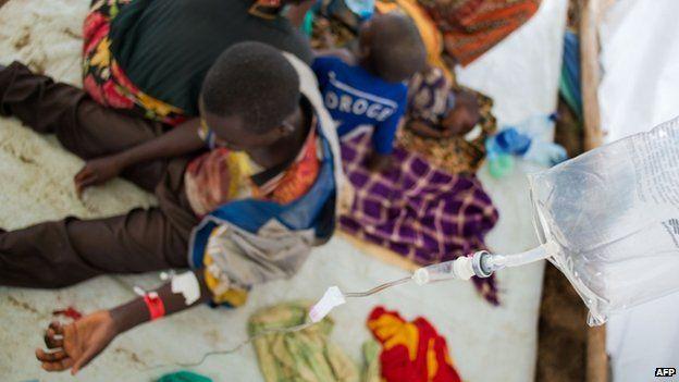Burundian refugees receive medical treatment in the fishing village of Kagunga, Tanzania on May 21, 2015