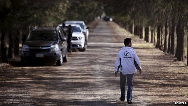 A Mexican officials walks at the ranch in Tanhuato. Photo: 22 May 2015