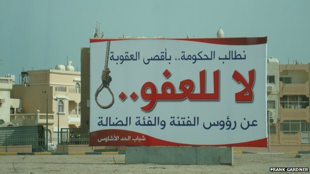 Inflammatory poster put up by Sunni hardliners in 2011 calling for no pardon for leading rioters; later taken down by the government