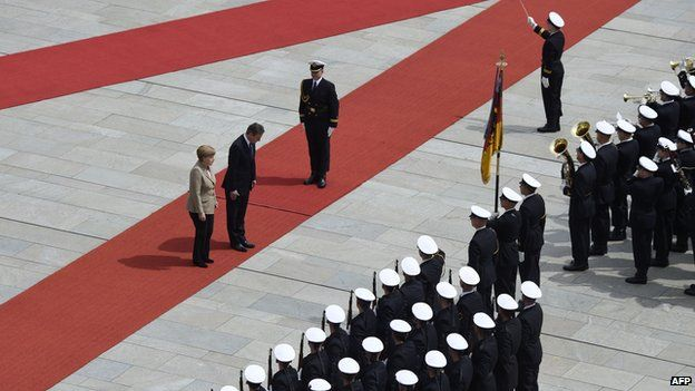 Angela Merkel and David Cameron inspect a military honour guard prior to a meeting
