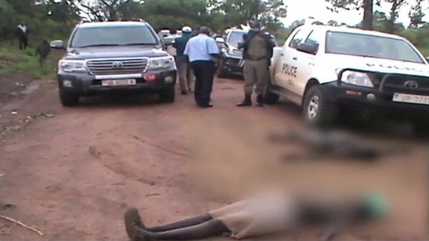 the two men roll around naked on the road on the day government officials came to demarcate the land.