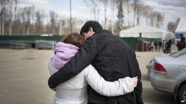 A couple at a migrant registration centre near Moscow, Russia (22 April 2015)