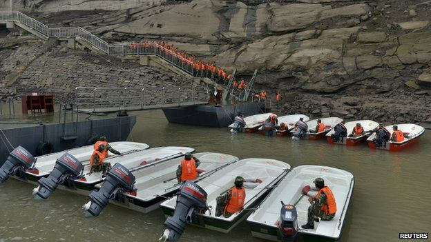 Paramilitary policemen assemble to get ready to travel to Hubei province for rescue operations after a ship sank in the Jianli section of the Yangtze River, at a port in Chongqing, 2 June 2015.