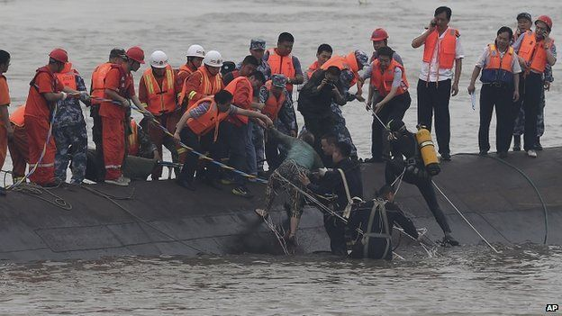 Rescuers save a survivor from the overturned passenger ship in the Jianli section of the Yangtze River in central China's Hubei Province on 2 June 2015