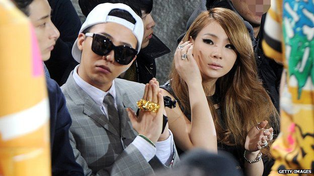 CL at a fashion show with fellow K-pop star G-Dragon
