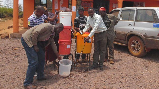 Askwar Hilonga showing people his water filter invention
