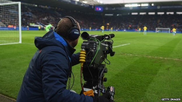 Television cameraman films the action during the Premier League match between Leicester City and Crystal Palace at the King Power Stadium