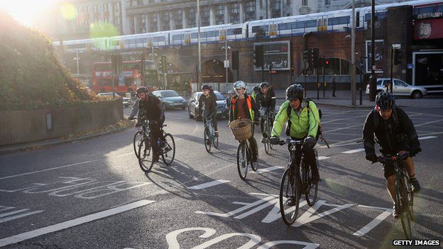Cyclists negotiate rush hour traffic in central London near Waterloo Station
