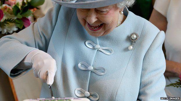 The Queen cuts a commemorative fruit cake