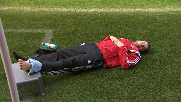Player resting with an ice pack on his ankle