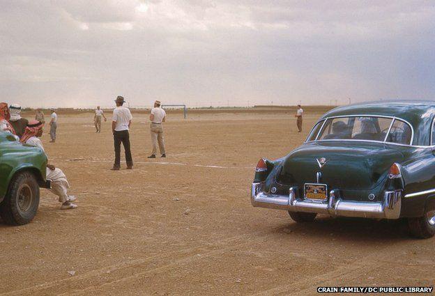 Cars near the baseball field