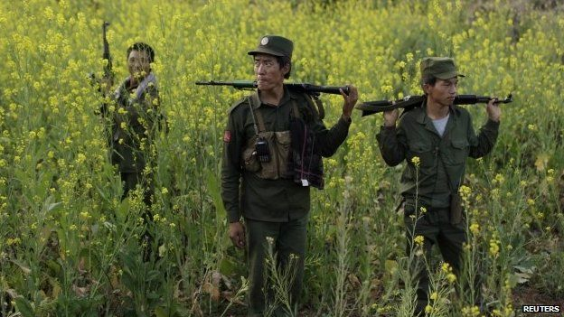 Rebel soldiers of Myanmar National Democratic Alliance Army (MNDAA) patrol near a military base in Kokang region, March 10, 2015.
