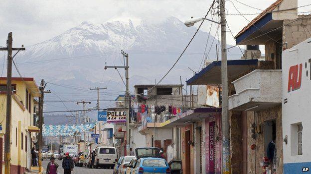 In this March 10, 2015 file photo, the Pico de Orizaba volcano rises above the town of Tlachichuca in Mexico's Puebla state.