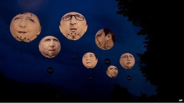Giant inflatable balloons of G-7 leaders hang in the air at night in Garmisch-Partenkirchen, southern Germany (June 7, 2015)
