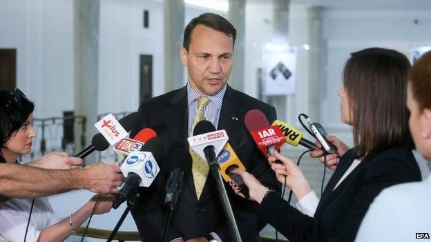 Polish Parliamentary Speaker Radoslaw Sikorski talks to reporters in Warsaw. Photo: 10 June 2015