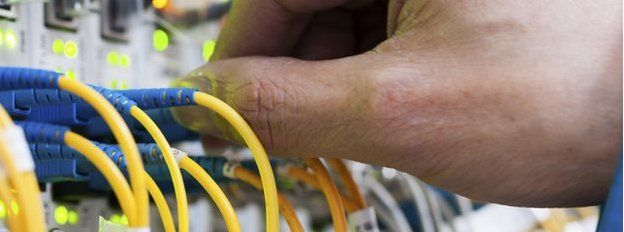 Ethernet cables being plugged in
