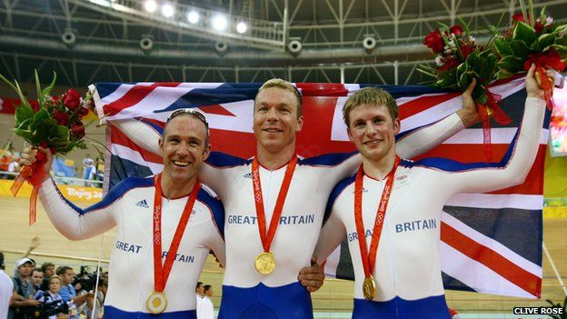 Jamie Staff, Chris Hoy, and Jason Kenny celebrate winning gold in the men's team sprint final at the 2007 Beijing Olympics
