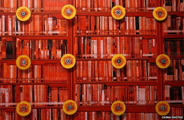 Discs are decorated on bookshelves at the 13th Beijing International Book Fair at China International Exhibition Center 30 August 2006 in Beijing, China.