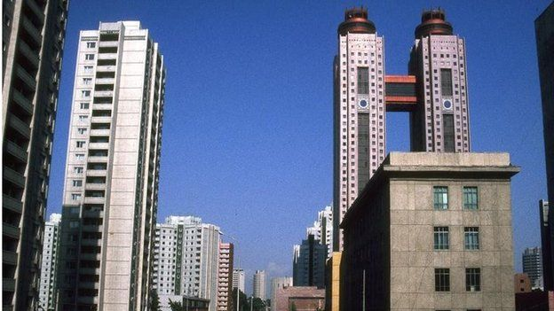 General view of main avenue in downtown Pyongyang, DPRK (Democratic People's Republic of Korea). To the right of frame can be seen the towers of the Pyongyang Koryo Hotel. Jan 2004