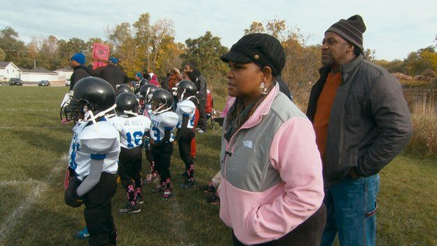 Brenda Myers-Powell watching a football game