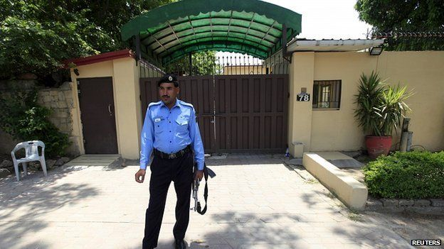 Policeman stands guard outside Save the Children office in Islamabad, Pakistan. 12 June 2015