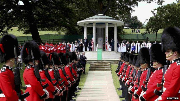 Soldiers march past a Magna Carta memorial