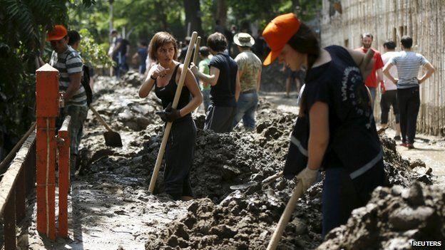 Volunteers clean debris at the zoo in Tbilisi, Georgia, on 15 June 2015.