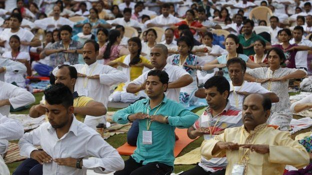 Yoga enthusiasts perform exercises as they participate in a prelude to the International Yoga Day at the Art of Living headquarters on the outskirts of Bangalore, India, Saturday, June 13, 2015