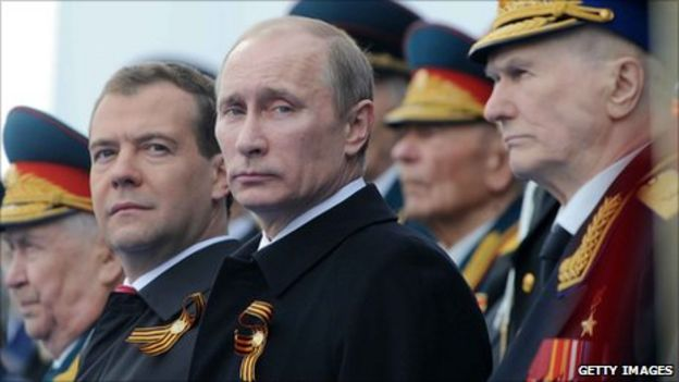 Dmitry Medvedev (left) and Vladimir Putin (centre) at Moscow's Victory Day parade (9 May 2011)