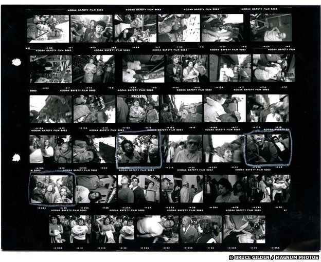 Bruce Gilden's contact sheet of pictures from the San Gennaro street festival in New York, 1984