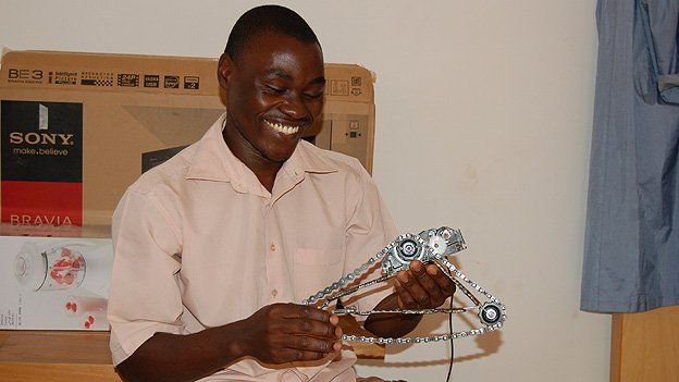 Victor Kwagga holds the robotic's club's latest project, made entirely from local found materials