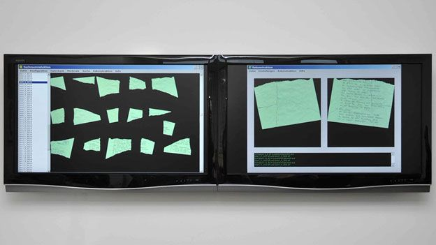 Torn papers on screen
